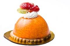 Delicious gourmet dessert orange mousse cream cake Stock Photography