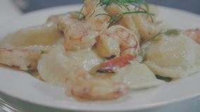 Gourmet pasta dish. Delicious gourmet pasta dish with prawns and white cream stock footage