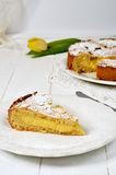 Italian grandma's cake. Delicious grandma's cake with cream on wooden table Stock Image