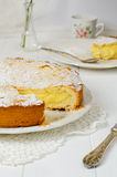 Delicious grandma's cake. With cream on wooden table Stock Images