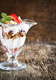 Delicious granola with berry in glass cup Royalty Free Stock Image