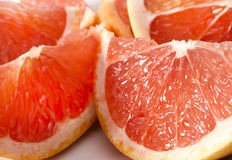 Delicious grapefruit parts. Close up of a couple of delicious grapefruit parts Royalty Free Stock Images