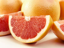 Delicious grapefruits. Couple of delishes grapefruits isolated on white Stock Photos