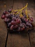 Delicious grapes in a ceramic bowl Stock Photo