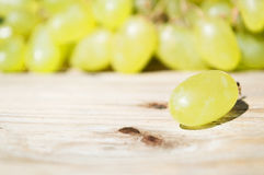 Delicious grapes on a table. Delicious grapes on a wooden table Royalty Free Stock Photography