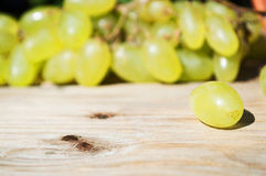 Delicious grapes on a table. Delicious grapes on a wooden table Stock Photography
