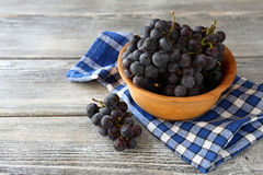 Delicious grapes in a wooden bowl Stock Images
