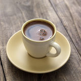 Delicious Greek  coffee. Perfect delicious Greek  coffee served in a  cup on wooden table Royalty Free Stock Photos