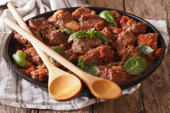 Delicious Greek food: stifado beef with sauce and basil close up Stock Images