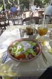Delicious Greek salad with Feta Cheese for Lunch In the Old Walled Town of Rhodes in Greece royalty free stock photos