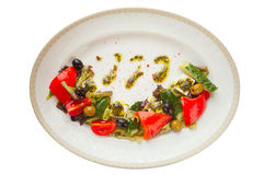 Delicious greek salad on  plate on white background Stock Photos