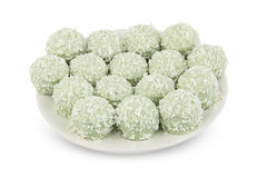 Delicious green coconut candies on white plate on  white backgro Stock Image