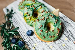 Delicious green doughnuts with berries royalty free stock images