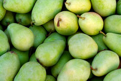 Delicious green pears. Green delicious pears at the market place Stock Photo