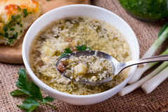 Delicious green soup with sorrel on table Royalty Free Stock Images