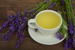 Delicious green tea in a beautiful glass bowl on table Stock Photography
