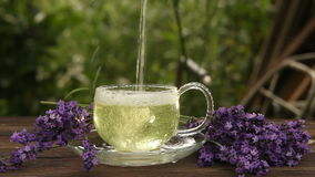Delicious green tea in beautiful glass bowl on table stock video