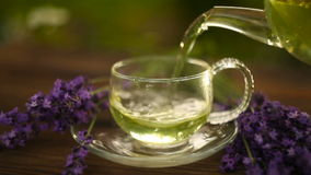 Delicious green tea in beautiful glass bowl on table stock footage