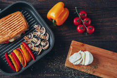 A delicious griled panini sandwich with mushrooms, cheese, pepper and tomato.  Stock Images
