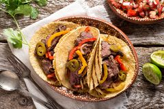 Grilled Beef Fajitas. Delicious grilled beef fajitas with steak, onion, bell peppers and jalapeno royalty free stock photos