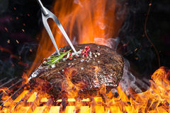 Delicious grilled beef steak on a barbecue grill. Stock Image