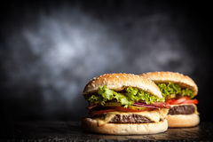 Delicious grilled burger. On black background Stock Photo