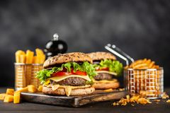 Delicious grilled burgers Royalty Free Stock Photos