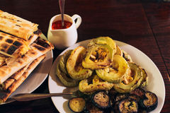 Delicious grilled eggplants and zucchinis. Royalty Free Stock Images