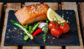 Delicious grilled filet of salmon with green asparagus, stock photos
