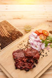 Delicious grilled marinated rack of lamb cut through to show the Royalty Free Stock Photos