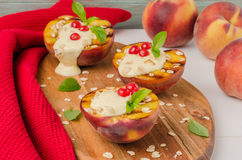 Delicious Grilled peaches dessert. Royalty Free Stock Photo
