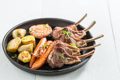 Delicious grilled ribs of lamb on white background Stock Photos