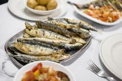 Free Delicious Grilled Sardines Served With Salad And Potatoes Royalty Free Stock Images - 125429889