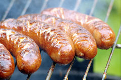 Delicious grilled sausages closeup