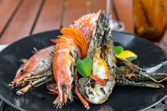 Delicious grilled seafood platter. Seafood platter delicious grilled prawn; rock lobster and red crab stock image