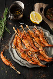 Delicious grilled shrimp with lemon, spices and sauce Royalty Free Stock Photo