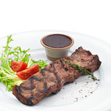 Delicious grilled steak. Isolated on white Royalty Free Stock Photo