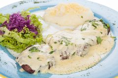 Delicious grilled steak topped with cheese sauce served with salad and potato puree Stock Images