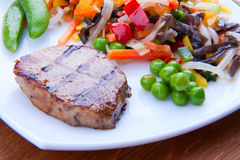A delicious grilled steak with vegetables Stock Images