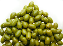 Delicious group of olives. Delicious group of shinny olives over a white background stock photo