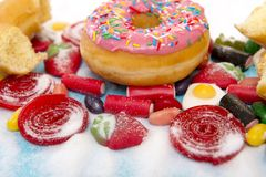 Delicious group of sweet sugar donut cakes and lots of gummy can royalty free stock photo