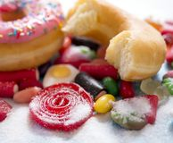Delicious group of sweet sugar donut cakes and lots of gummy can royalty free stock images