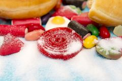 Delicious group of sweet sugar donut cakes and lots of gummy candies isolated in lifestyle nutrition health care Stock Photo