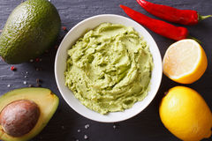 Delicious guacamole sauce close-up on the table. Horizontal top Royalty Free Stock Photography