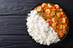 Delicious gumbo with prawns, sausage and rice on a plate. Horiz