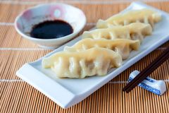 Delicious gyoza or pot stickers on bamboo mat Royalty Free Stock Image