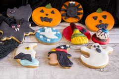 Delicious halloween cookies on wooden background Stock Photography