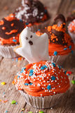 Delicious Halloween cupcakes with a spooky close-up. Vertical Stock Images