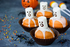 Delicious Halloween treat for dessert, pumpkin chocolate muffins Royalty Free Stock Images