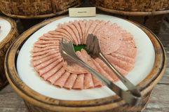 Delicious ham arranged on white plate. (be partly consumed Stock Image